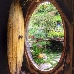 hobbithouses:  Peeking out from inside a hobbit hole. by Yes to Adventure on Flickr.