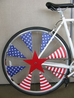 4th of July Party {Bike Parade Decorating-cut triangles out of red, white and blue paper and attach to spokes}