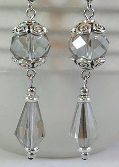 These unique earrings are made with light gray faceted glass crystal beads and pewter beads and bead caps. The antiqued pewter bead caps hav… Crystal Jewelry, Wire Jewelry, Jewelry Crafts, Beaded Jewelry, Jewelery, Glass Crystal, Faceted Glass, Crystal Beads, Swarovski Crystal Earrings