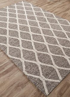 The handspun quality of this simple, raised motif infuses this rug with a three-dimensional, sculptural quality that will appeal to consumers wanting to create a homey atmosphere.