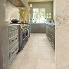 "Update your kitchen with grey cabinets and beautify your floors with tile in style ""Summerwind"" by Shaw Floors Grey Kitchen Cabinets, Kitchen Tiles, Kitchen Flooring, Tile Flooring, Kitchen Colors, Living Room Flooring, Kitchen Remodel, Kitchen Reno, Kitchen Stuff"