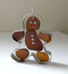 Idea for a Christmas craft. Make a ginger man sea glass ornament with a cookie cutter.