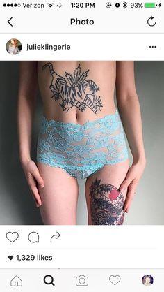 I kind of really want a big fierce tummy tattoo like this