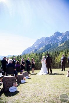 Amanda & Jarrett's Rustic Romantic Wedding.  Photographer: Emily Exon Photography  Venue: Mount Kidd, Delta Kananaskis Lodge  Planner: Mountain Bride  Officiant: Robin White  Flowers: Flowers by Janie  Caterer: Delta Kananaskis Lodge  Dessert Table: Delta Kananaskis Lodge  Hair/Makeup: Simply Me  Bride's Attire: David's Bridal  Grooms Attire: J. Crew  Entertainment/Lighting: Bow Valley DJ Barrymore