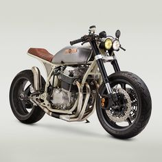 """HYPEBEAST on Instagram: """"A project nearly four years in the making, Virginia-based workshop @classifiedmoto has finally finished overhauling one Honda CB 750 cafe racer. Drawing inspiration from vintage aircrafts, the revamped motorcycle sports a quasi-white color and features a vintage Cessna airplane fuel cap. Photo: @adamewing"""""""