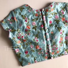 The Turquoise Birdy Blouse is now available at Peach project! Loving the silk thread embroidery on this blouse. Blouse Designs High Neck, Best Blouse Designs, Simple Blouse Designs, Stylish Blouse Design, Sari Blouse Designs, Designer Blouse Patterns, Bridal Blouse Designs, Blouse Models, Dress Models