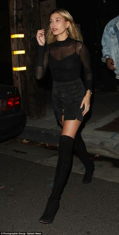 Made for walking: Hailey flashed her long legs in thigh-high boots as the models partied in West Hollywood