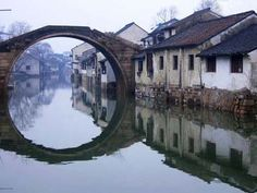 """Nanxun Water Town in China's Yangtze Rive Delta, southern shore of Taihu Lake. It's the eastern gate of Huzhou City, Zhejiang Province to Shanghai. Nanxun, meaning """"South of the Xun River"""", is famous for it silk production. In ancient China silk was generallya cottage industry run by females of the village. Every family tended the silkworms and harvested silk thread from the cocoons."""