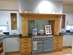 """This is our """"Bluegrass"""" splashback design, going beautifully with the blue Falcon cooker, in a John Lewis Leckford kitchen display at the Aberdeen store. Kitchen Display, Splashback, Aberdeen, John Lewis, This Is Us, Cooker, Kitchen Cabinets, House Styles, Store"""