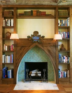 French Country Cottage Fireplace: The light scones are attached right onto the facade & there are surrounding built-in shelves. Design by Barnes Vanze Architects // fireplace hearth tile ideas Rustic French, French Country Cottage, French Country Style, French Country Decorating, Country Cottages, French Country Fireplace, Ap French, Classic Fireplace, French Farmhouse