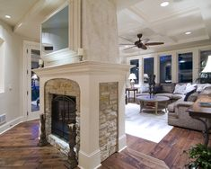 Family Room Design - fireplace in the middle, lots of windows