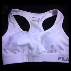 Fila high-impact running sports bra -Medium- New condition, tried on but never have worked out or went running with it as it is too tight for me. The last picture shows a slight marking that I don't know where it came from, maybe a bit of makeup? Barely noticeable none the less!!! :) Great deal for whom ever buys this! I will take an offer but you must use the button option to do so! I will discount $5 (pays for shipping!!!) off of this listing only with a bundle! Fila Tops