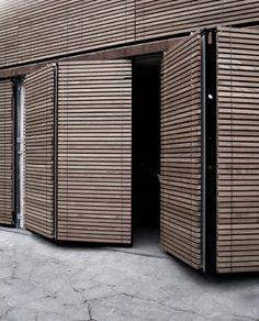 Bi-fold bespoke timber clad garage doors http//www.pinterest.com/avivbeber3/beautiful-garage-doors/