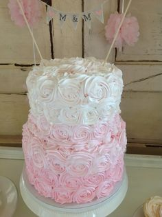 Pink Ombre Rose Cake Wedding. Love the banner opposed to the traditional bride and groom!!