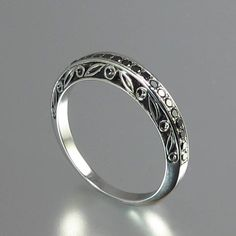 UNDER A SPELL Wedding Band 14k gold and Black by WingedLion