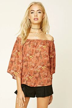 A woven top featuring an off-the-shoulder collar, floral print, long bell sleeves, and a boxy silhouette.