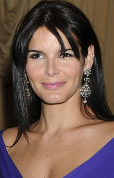 Angie Harmon. Love the hair and earrings hear, Angie is always stunning in that Latin way!
