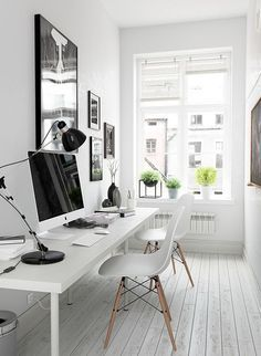 Love the plants lining the window in this home office <3 The white dining chairs are a cool change from those bulky office chairs and the gallery wall behind the computer is so cute. Get our top 10 tips to create your perfect workspace here >>