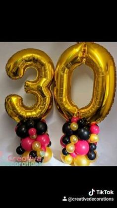 Air filled 30th birthday balloon display with gold number balloons and gold, black and pink latex balloons Gold Number Balloons, Helium Balloons, Latex Balloons, Balloon Display, Balloon Decorations, 30th Birthday Balloons, Balloon Designs, Pink, Black