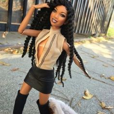 """Singer @4everbrandy got the internet all kinds of hyped last week when she posted this Instagram of Barbie Brandy with the appropriate caption: """"Yesssssss."""" Turns out @4everbarbiebrandy isn't brand new. The brainchild of photographer/digital artist Tyren Red Barbie Brandy first landed on Instagram in October 2015. """"Taking that idea and creating a Instagram account with a doll that embodies that same energy with love and empowerment in every post I felt was needed in a world where there's not…"""