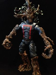 this is a marvel legends Groot Guardians of the Galaxy Custom Action Figure he was made by figure realmer therealsupaman he used a marvel icons punisher body, with lord of the rings talking ent arms, legs and branches on his head fixed with apoxie happy pinning