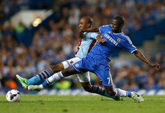 Chelsea's Ramires, right, vies for the ball with Aston Villa's Fabian Delph during the English Premier League soccer match between Chelsea and Aston Villa at Stamford Bridge Stadium in London, Wednesday, Aug. 21, 2013. (AP Photo/Kirsty Wigglesworth)