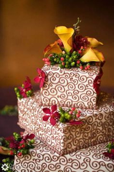 Autumn wedding cake with red and orange flowers