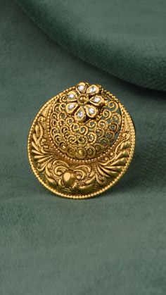 Statement crescent ring enthralls with ornamentation and a kundan bloom Gold Jhumka Earrings, Indian Jewelry Earrings, Gold Rings Jewelry, Jewelry Design Earrings, Gold Earrings Designs, Gold Jewellery Design, Antique Jewellery Designs, Gold Ring Designs, Gold Pendent