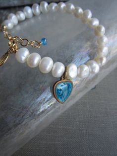this is a bracelet made of beads extracted from the seabed with said virgin de guadalupe cost is hundred pains