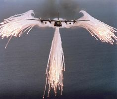 This will be in my next painting.  Air Force C130 Hercules aircraft giving off flares.  This is normal that it looks like angel wings.  Ridiculously awesome.