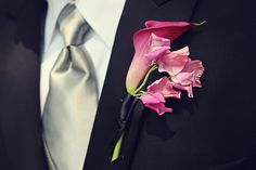 A gorgeous boutonniere featuring a big pink calla lily by Petalworks.