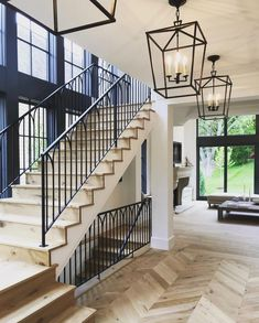 stairs, wood white and black, hanging lantern pendants - treppe. Home Interior Design, Interior And Exterior, White House Interior, Design Homes, Interior Trim, Planchers En Chevrons, Future House, Stair Railing, Railings