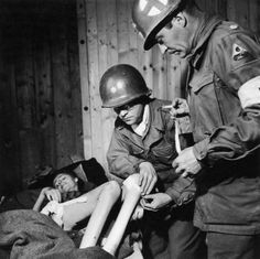 HEROES. American medics tending to an emaciated former inmate of the Penig concentration camp after its liberation by Allied troops, sometime in 1945.