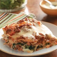 Ground Beef Spinach Alfredo Lasagna Recipe -With two types of sauces, ground beef, spinach and three kinds of cheese, this dish is super hearty and goes beyond the expected. When serving, be sure to scoop all the way down to the bottom of the slow cooker so that everyone gets a good taste of this many layered meal. —Deborah Bruno, Mira Loma, California