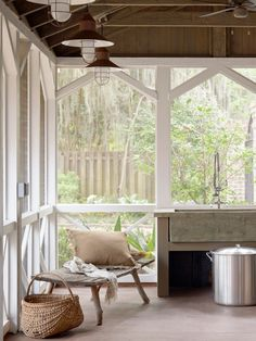 screened porch with cool lighting and those arched beams. What is that amazing sink?
