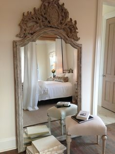 I love this huge distressed ornate leaning wood mirror!