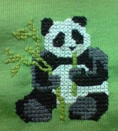 $14.95      Panda    Size 2  Very stretchy pea green T-shirt.  Hand sewn with the gorgeous giant panda eating his favourite lunch – bamboo.  Great for every day wear, match it with shorts or jeans.  Sized to fit Height 92cm  Chest 56cm  Waist 54cm  Looks to be a very close weave with lots of stretch so a close fitting top.  Cotton