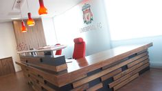 WORLD-renowned football club, Liverpool FC, boasts a headquarters that's as sleek and impressive as the football skills for which its team is celebrated. The red-hued colour scheme signifies the club's prime colour and complements the predominantly wooden decor to create a pleasingly contemporary, almost corporate appearance and feel. The walls are mounted with graphics devised by Artworks Solutions and constructed by Nobles Construction Ltd. referencing the heritage of the club and its…
