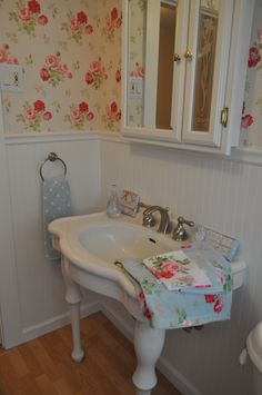 My Cath Kidstoned up guest bathroom! :).  Had to make old retro blue bath tiles work somehow and this seemed like the only solution. Antique Rose Cath Kidston Wallpaper, Cath Kidston bath towels pink dot & blue dot. Retro Girly Vintage Fun 50s style bathroom. Hilda Pinup