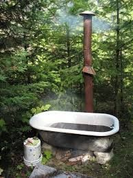 Best 12 This is what a friend of Greg's did with their backyard. Love it, the fire below the tub, heats up the water. Outdoor Bathtub, Outdoor Bathrooms, Garden Bathtub, Piscine Diy, Natural Swimming Pools, Natural Pools, Pool Landscaping, Backyard Pools, Pool Decks