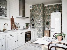 Kitchen with green vintage wallpaper