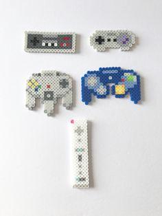 "NES: 3.25"" x 1.5"" Super NES: 3"" x 1.5"" N64: 3"" x 3"" Gamecube: 3.75"" x 2.5"" Wii: 1"" x 4"""