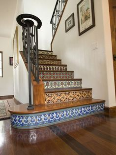 I love Spanish and Italian tile - 4) Hand painted tiles on stair risers. These stair risers are covered with colorful Catalina style tiles, which combine glossy and matte finishes. This adds wonderful depth to the patterns.
