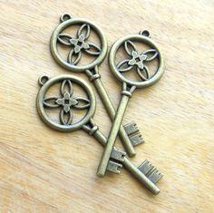 50 skeleton key replicas (2.75) - antique brass finish skeleton key ornaments - bulk skeleton keys. $38.00, via Etsy.