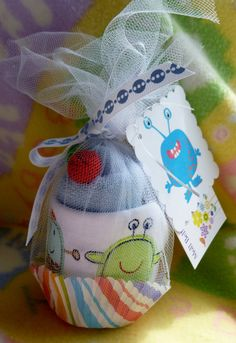 The little monsters from this vendor are the cutest!  Packaged great for giving at a shower! My Little Monster Bib and Two Washcloth by mollbelldesigns on Etsy, $6.25