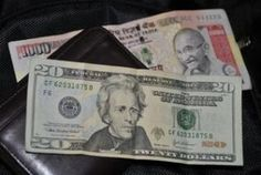 Rupee recovers from record low, up 19 paise vs Dollar value