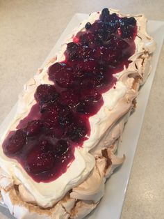 Berry coulis topped pavlova