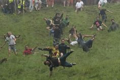 Competitors take part in the annual cheese rolling competition at Cooper's Hill. Action Photography, Love Photography, Happy Images, Carnival Festival, Cheese Rolling, All The Way Down, Photos Of The Week, Health And Safety