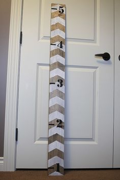 DIY growth chart for the boys. LOVE the chevron pattern! Gray/white or exposed/white.
