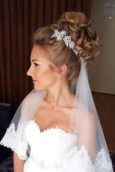 wedding hairstyles with veil high bun weddingstylist